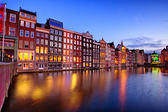 Blue Hour in Damrak (Pat Charles) Tags: longexposure holland reflection water netherlands amsterdam architecture night reflections lights canal nikon reflected bluehour 1001nights damrak 1001nightsmagiccity