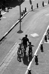 Father and Son (Jamila Hajam) Tags: white black walking hand father son kind fahrrad vater strase