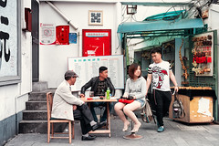 Odd Meeting (Jon Siegel) Tags: china woman men boys girl table outside outdoors 50mm nikon afternoon shanghai 14 chinese drinking sigma meeting smoking odd alleyway mysterious d810 sigma50mmf14art