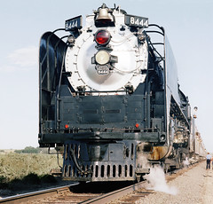 Union Pacific FEF-3 class 4-8-4 Northern steam locomotive # 8444, is seen while stopped on a rail fan trip out of Denver, Colorado, Summer 1980 (alcomike43) Tags: old people color classic modern vintage ties photo colorado tracks trains historic passengers negative photograph rails unionpacific wyoming northern steamengine railroads ballast rightofway steamlocomotive 484 alco mainline oilburner passengertrains roadbed railfans 8444 fef3 tieplates anglebars lightweightpassengercars conventionaljointedsectionrail railfanexcursiontrains