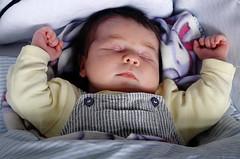 Another sleepy photo (gornabanja) Tags: sleeping portrait baby cute face hands nikon infant d70 little small sleepy tired tiny newborn asleep fists