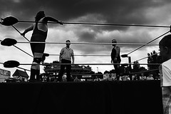 The Wrestling Match (stuartmayo62) Tags: sky people bw cloud white male men sports monochrome sport clouds wrestling bland males fighting spectator