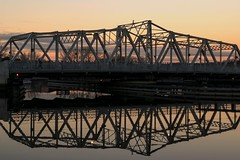 Reflections on the river (Ben De La Rosa) Tags: county bridge sunset scale reflections river steel symmetry warren bergen hackensack truss swingspan nikond3300