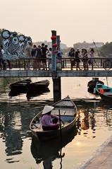 Tourist bridge (Roving I) Tags: tourism vertical reflections boats evening bridges tourists vietnam hoian rivers conicalhats