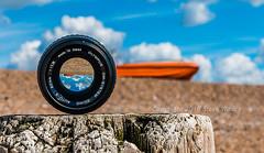 Orange Boat (SteveW@aps) Tags: beach lens sussex worthing throughthelens
