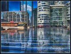 Kind of Blue (baladeson) Tags: blue sky paris france water architecture buildings eau bleu ciel fontaine reflets ville ladfense reflects btiments hautsdeseine