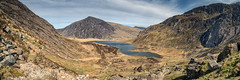 Llyn Idwal Panorama (Howie Mudge LRPS) Tags: uk travel sky panorama terrain lake mountains travelling tourism nature water grass wales clouds landscape scenery rocks pano ngc cymru scenic scene panoramic hills panasonic ridge boulders valley bracken snowdonia rugged ridges csc gwynedd cwmidwal llynidwal fantasticnature mirrorless micro43 microfourthirds mirrorlesscamera compactsystemcamera lumixgvario1442f3556ii micro43mountlenses panasonicdmcgx8