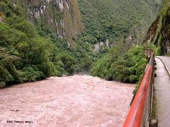 The Turbulent Urubamba River Flows Adjacent to the Road to Machu Picchu at Agua Calientes, Urubamba Province, Peru (Black Diamond Images) Tags: peru southamerica train perú machupicchu urubambariver américadosul riourubamba aguacalientes amériquedusud perurail zuidamerika sudamérica republicofperu repúblicadelperú urubambaprovince