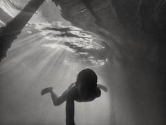 Rays And Darkness (photo-razzo) Tags: boy sea blackandwhite bw water asian southeastasia underwater child availablelight nationalgeographic humaninterest elnio blackedition flickraward goprohero3 discoveryphotos goprohero3blackedition