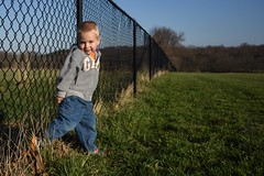 Innocence  (HFF) (SaltyDogPhoto) Tags: family boy portrait people portraits fence nikon dof child naturallight sunny bluesky depthoffield human innocence chainlinkfence nikkor colby hff nikonphotography fencefriday fencedfriday nikond7200 saltydogphoto nikkor1680mmf284eedvr