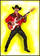 Rock A Tommy (Cowboy Tommy) Tags: portrait music hairy hot sexy hat leather fashion sex beard cowboy legs boots guitar blueeyes country crotch popart western rockabilly rocknroll buckle bulge skintight leatherpants