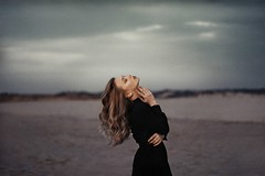 The girl with the flaxen hair (.everlasting) Tags: sea portrait girl dark hair skies grain poetic melancholy mystic blackness everlasting flaxen feverdreams hadararielmagar