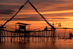 Sunrise At Phatthalung Lake (spanjavan) Tags: morning sky sun lake net silhouette clouds sunrise thailand structure southern