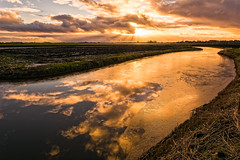 Fire, Water And Ice (Alfred Grupstra Photography) Tags: light sky ice water grass clouds reflections landscape nikon sundown nederland nl noordholland oostwoud