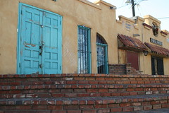 storefront (dbodinem) Tags: door new old city urban southwest west building brick shop architecture buildings mexico store angle walk turquoise south low bricks steps albuquerque structure lead displaybars