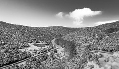 Way up to the...cloud (Nick Panagou) Tags: road light sky bw snow mountains clouds contrast landscape blackwhite village dramatic greece greatphotographers bestshotoftheday magnesia canon400d bestphotographer canonefs1855mmf3556isii