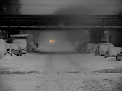 Car headlight in the snow (Robert S. Photography) Tags: street nyc winter bw snow storm monochrome car brooklyn canon subway lights january overpass powershot vehicles blizzard snowcovered selectivecolor 2016 iso160 elph160