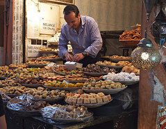 Pastry seller in the souk (nisudapi) Tags: food market stall morocco pastry sweets marrakech souk marrakesh oldcity 2015 djemaaelfna