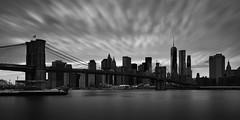 Manhattan panorama 2 (another_scotsman) Tags: longexposure bridge blackandwhite panorama newyork brooklyn cityscape manhattan