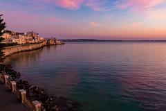 After the sunset - Ortigia (Sicily) (Giovanni Tumminelli) Tags: blue sunset italy lighthouse canon walking golden colorful tramonto blu hour syracuse sicily ora lungomare castello sicilia siracusa ortigia ortygia