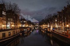 Smoke on the Water (McQuaide Photography) Tags: city longexposure winter light urban house holland reflection water netherlands dutch amsterdam architecture zeiss photoshop outside licht canal twilight lowlight europe waterfront outdoor dusk sony tripod capital nederland houseboat fullframe alpha huis residential waterside stad manfrotto noordholland gracht lightroom brouwersgracht huizen capitalcity 1635mm woonboot northholland a7ii variotessar mirrorless sonyzeiss mcquaidephotography ilce7m2