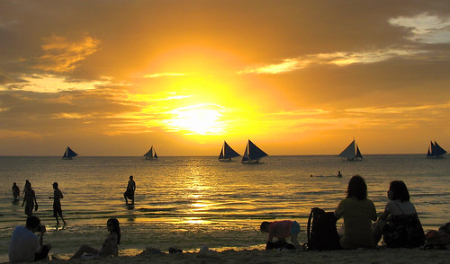 ocean sunset sun water silhouette clouds boats asia paradise sailing pacific philippines tourists tropical boracay visayas whitebeach aklan