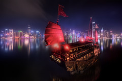 SYMPHONY OF LIGHTS (Titanium007) Tags: china city red urban water skyline architecture night sailboat reflections hongkong boat junk asia neon cityscape colours skyscrapers lighttrails nightphoto fareast sampan nightexposure victoriaharbour symphonyoflights