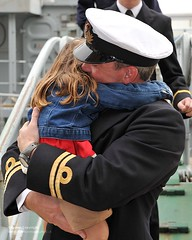 A Royal Navy Officer Hugs His Daughter After Returning from a Long Deployment on HMS Chiddingfold (demassimiliani) Tags: uk family male girl happy hugging dad child military father joy daughter hampshire homecoming cuddle portsmouth british sailor defense cuddling defence officer lt personnel lieutenant royalnavy nonidentifiable