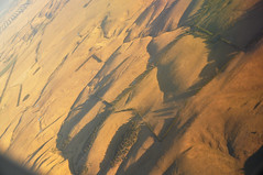 DSC_0626 [ps] - Hard Dunes (Anyhoo) Tags: shadow summer brown texture grass fence landscape countryside flying view flight dry australia victoria farmland hills pasture hedge vic geography boundary arid lowsun dun crumpled copse inflightentertainment arbitrary viewfrom windbreak viewfromtheplane anyhoo photobyanyhoo fentonhillfarm
