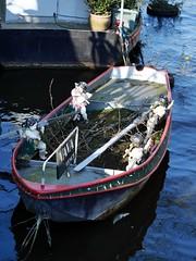 Ship of Putti - 2 (the justified sinner) Tags: wood netherlands amsterdam boat canal md minolta 14 panasonic cherub bella 50 vena hideous putti rokkor gx7 justifiedsinner