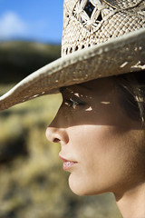 Woman in straw hat. (sunil.cheloor) Tags: shadow portrait color face vertical closeup outdoors hawaii unitedstates profile posed sunny maui headshot photograph shade sideview cowboyhat protection strawhat southwestern caucasian onepersononly midadultwoman 3035years