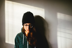 (Duke of Gnarlington) Tags: light shadow glasses elizabeth blinds beanie zeiss35mm28 sonya7ii