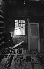 Shambles (Tales End) Tags: new york city nyc urban house abandoned film broken window 35mm nikon decay eerie haunted warehouse forgotten astoria exploration ilford nikkormat urbex