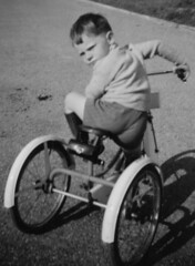 Come On (theirhistory) Tags: road street boy england kid child play wheels kinderen jumper trike shorts wellies welllingtonboots