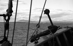 Mt Desert Island From Sch Roseway 8-23-1988mrf4 (ironmike9) Tags: ocean sea sky water clouds islands bay coast boat seaside ship maine vessel atlantic hills anchor sail schooner seacoast roseway