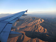 crossing the desert (kenjet) Tags: mountain landscape inflight afternoon desert nevada wing aerialview aerial windowview fromthewindow winglet onboard wingtip mountainrange virginamerica