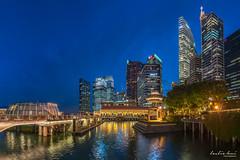 Ultra Blue (leslie hui) Tags: city panorama hotel singapore cityscape cbd bluehour centralbusinessdistrict marinabay panoromic singaporefinancialdistrict fullertonbayhotel