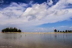 Under The Blue Sky (Galib Emon) Tags: blue sea sky copyright cloud white lake tree beach nature water canon landscape eos is seaside outdoor shore 7d bangladesh emon coxsbazar f3556 galib underthebluesky inanibeach efs18135mm
