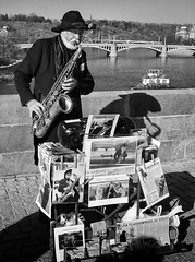 The saxophone man (trochford) Tags: bridge urban blackandwhite bw musician music man monochrome canon river person mono blackwhite czech prague outdoor prag praha player czechrepublic streetperformer busker performer sax charlesbridge vltava saxophone streetmusician karlvmost