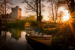 The Anglers Fancy (kisko-Sonia) Tags: bridge ireland sunset castle sol rio river landscape puente atardecer ross nikon barco sigma paisaje killarney naranja castillo irlanda bout rosscastle d7100