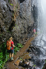 Walking behind waterfall at Springbrook NP (NettyA) Tags: waterfall hiking australia bushwalking qld queensland hikers bushwalk springbrook goldcoasthinterland 2016 springbrooknationalpark scenicrim bushwalkers seqld warriecircuit blackfellowfalls scbwc sonya7r
