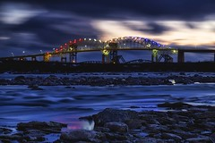st. marys rapids / sault ste. marie international bridge (twurdemann) Tags: longexposure bridge sunset water spring rocks bluehour saultstemarie 30seconds internationalbridge stmarysriver neutraldensityfilter unitedstatesborder canadaborder stmarysrapids hoyandx8 internationalrailroadbridge 06ndhardgrad gnd2h fujixe1 leeseven5 xf55200mm