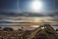 Sun halo over Crescent Beach (Repp1) Tags: sunset sun canada beach clouds soleil rocks bc crescentbeach nuages plage roches crystalball coucherdusoleil sunhalo bouledecristal halosolaire