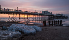 New Years Day  Worthing pier (Trojan Wonder) Tags: sea beach water architecture clouds sunrise reflections pier worthing sand stones shingle newyear structure shore groyne 2016 robcarter