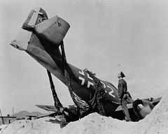 US Staff Sargeant examines German  Messerschmitt Me262-22 at Salzburg Austria in May 1945 (tormentor4555) Tags: white black salzburg austria may ww2 1945 messerschmitt jv44 61stgroup44jagdverband44 me26222