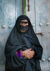 an old bandari woman wearing a traditional mask called the burqa, Qeshm Island, Salakh, Iran (Eric Lafforgue) Tags: door portrait people woman vertical outdoors photography clothing asia veil mask iran muslim islam traditional religion hijab indigo persia hidden identity human elderly covered iranian adults adultsonly oneperson islamic burqa ethnicity frontview persiangulf sunni elderlywoman qeshmisland chador hormozgan onewomanonly lookingatcamera burqua handscrossed  bandari  blackveil 1people  iro straitofhormuz  colourpicture  salakh borqe boregheh irandsc04615