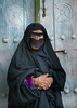 an old bandari woman wearing a traditional mask called the burqa, Qeshm Island, Salakh, Iran (Eric Lafforgue) Tags: door portrait people woman vertical outdoors photography clothing asia veil mask iran muslim islam traditional religion hijab indigo persia hidden identity human elderly covered iranian adults adultsonly oneperson islamic burqa ethnicity frontview persiangulf sunni elderlywoman qeshmisland chador hormozgan onewomanonly lookingatcamera burqua handscrossed إيران bandari иран blackveil 1people イラン irão straitofhormuz 伊朗 colourpicture 이란 salakh borqe boregheh irandsc04615
