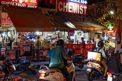 Delhi, India night, view09 (lumierefl) Tags: india night market delhi motorcycles pharmacy storefront produce fruitstand drugstore shoppers newdelhi chemist southasia nationalcapitalterritory