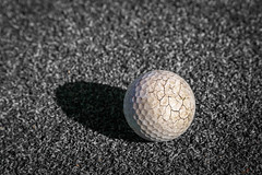 Crack golf ball (jack-sooksan) Tags: old shadow sunlight white abstract black game broken field grass sport yard ball golf grey break play floor antique ground crack aged concept rough split fairway links fracture chapped parting cloven