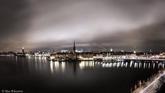 View over a stunning Stockholm (max.wikstrom) Tags: city longexposure panorama water skyline reflections outside sweden stockholm nightphoto scandinavia dramaticsky longexpo stockholmbynight stockholmskyline